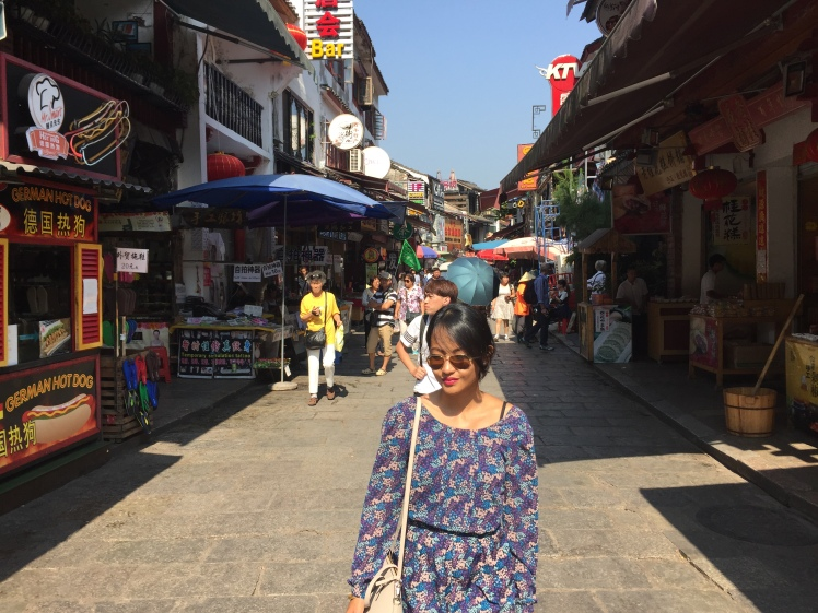 On Yanghsuo's West Street, where you can find all the tourist essentials like bike rental/tour shops, Western and Chinese food alike, souvenirs, etc.