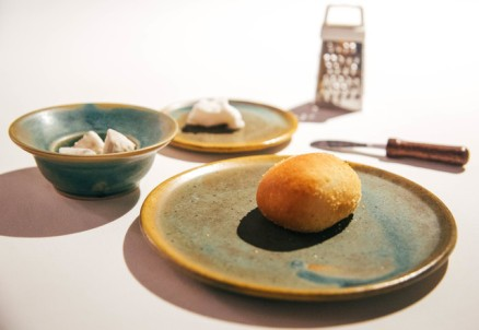 Mini-pandesal with coconut butter sprinkled with coconut salt