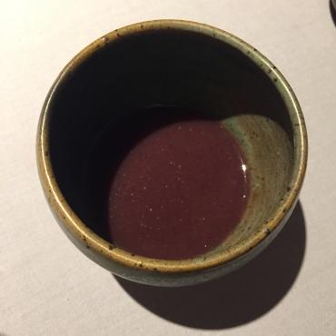 Arroz caldo of heirloom black sticky rice with jamón ibérico